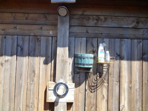 behind the guest cabin: a fully enclosed outdoor shower