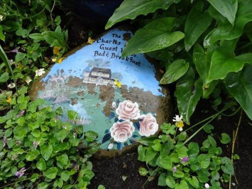 This painted stone sits near the birdbath.