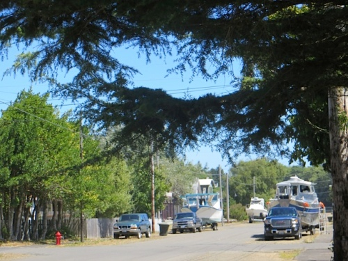 Ann was amused by the view east from our front gate, with three boats parked along the street. Normal for Ilwaco.