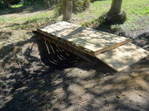 bridge of recycled lumber and pallets