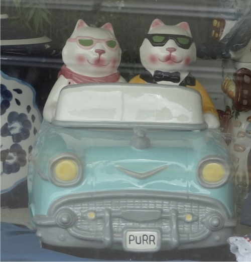 "a cheering sight"" my favourite cookie jar in the Cottage Bakery window."