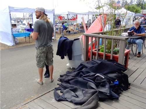 Salt Hotel: cleaning wetsuits from a surfing lesson (a sideline of theirs)