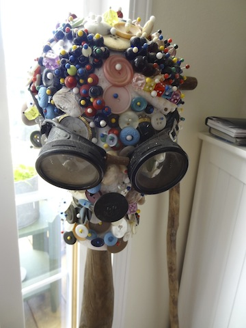 a button head with watches for eyes