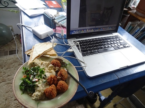 later at home: a falafel plate with hummous, baba ganoush, tabouli....O! Joy.
