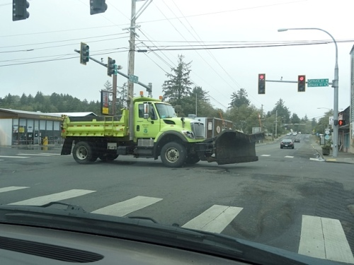 a snowplow heading east to push debris off the road.