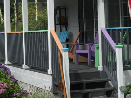 The porch railing tops are painted to match the adirondack chairs.