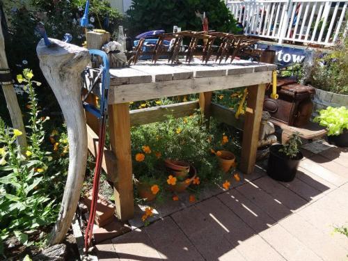 garden table divides kitchen garden from flower garden