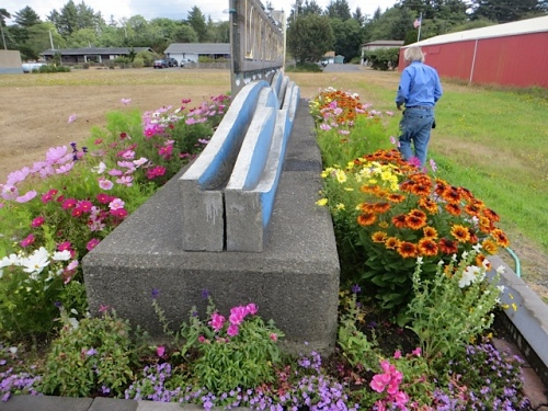 deadheading and supplemental water at the welcome sign