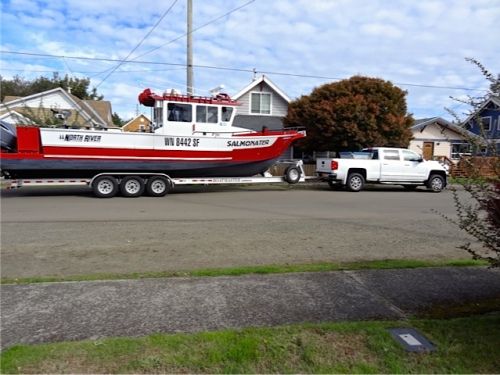Just as we left for work, our neighbour two doors down was heading off with his handsome boat, The Salmonater.