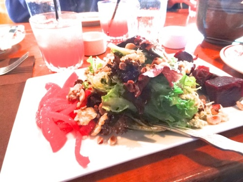 "a salad of onions, arugula, beets, with an ""Irish Wake"" (cranberry, lemon, Irish whiskey)"