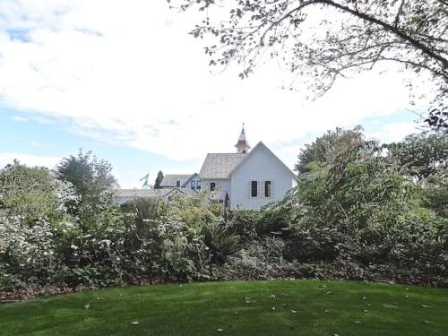 Part of the garden lies behind the next door church.