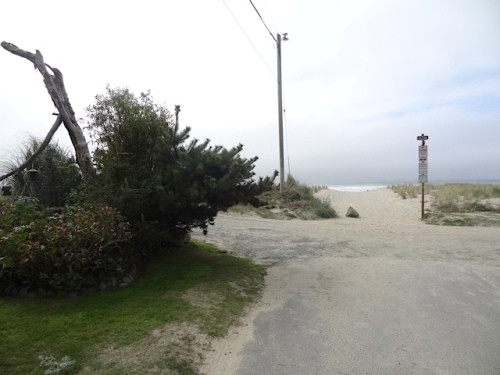intersection of beachfront road and dune path