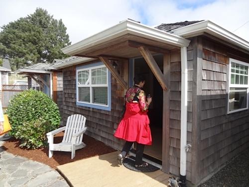 A tour guest enters cottage 5.