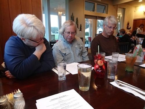Kathleen, Allan, and Todd peruse the menu