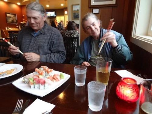 Dave and Melissa practice their chopstick skills.