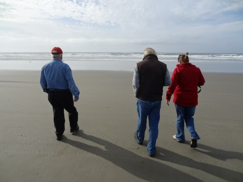Gary, Allan and Karla on the clean wet sand.