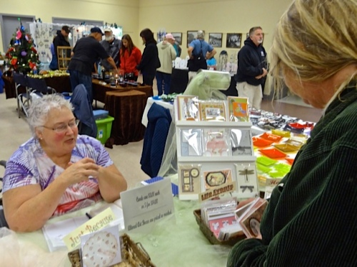 We bought an assortment of delightful handmade cards from this vendor. (Allan's photo)