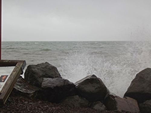 waves splashing up over the breakwater