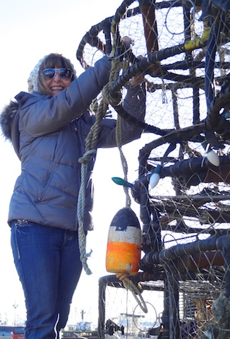 Diane decorating the crab pot tree