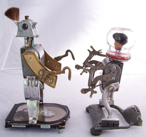 Surge-Yo and Surge-Yo's Sister. 11 and 9 1/2 inches tall respectfully. Both made of found objects by Joe Chasse 2009 (Joe's photo)