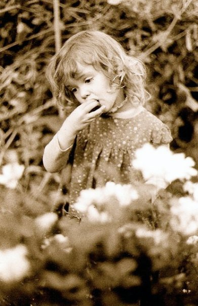 Cori eating tomatoes in my garden, summer 1980