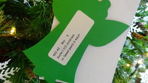 Pick an ornament from the tree and get a gift for a child.