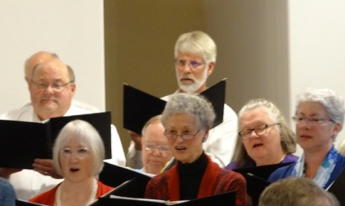 Suzanne (center, in read, soprano) with Todd (bass) behind her.