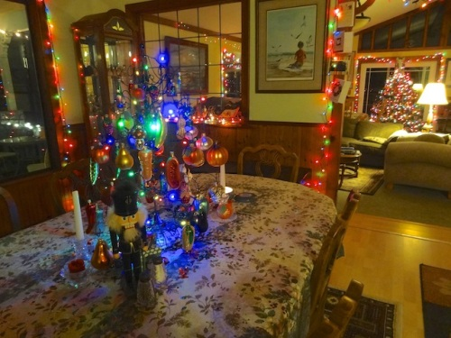 The ornaments on the table tree are all fruits and veg.
