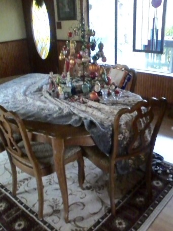 Melissa's photo. Fortunately, the cats did not get the little tree and its fragile ornaments pulled off the table.