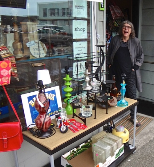 He found Heather of NIVA green setting up for the annual Peninsula-wide garage sale weekend.