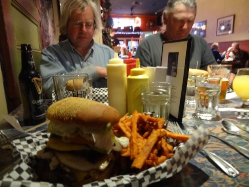 Allan and Dave seriously contemplate their burgers.