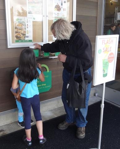 Allan helped another shopper donate a bean.