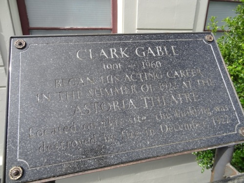 a plaque by the sidewalk