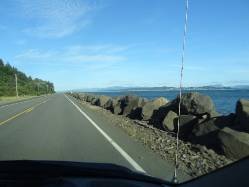 driving east along the Columbia River toward the bridge. You can see Astoria across the water.