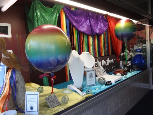 a shop window decorated for Pride weekend
