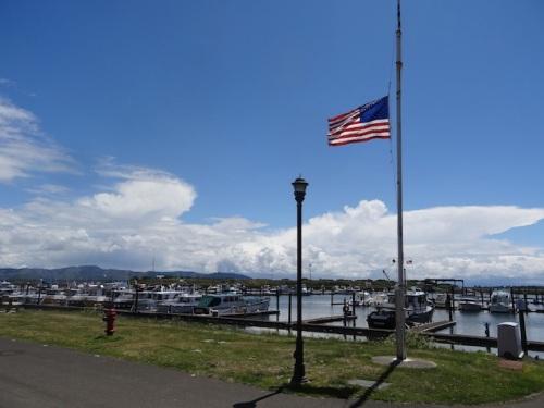 half mast flag at the marina