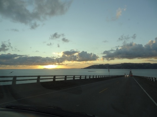 view from the bridge going home, with a golden glow over Ilwaco