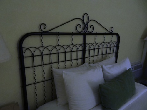 The headboards were like old garden gates.