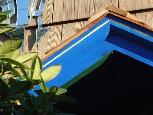 He painted the edge of his porch roof project.