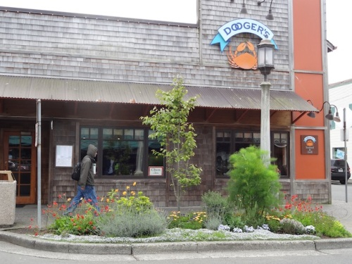 Pam often plants culinary plants in front of restaurants, like this seafood place.