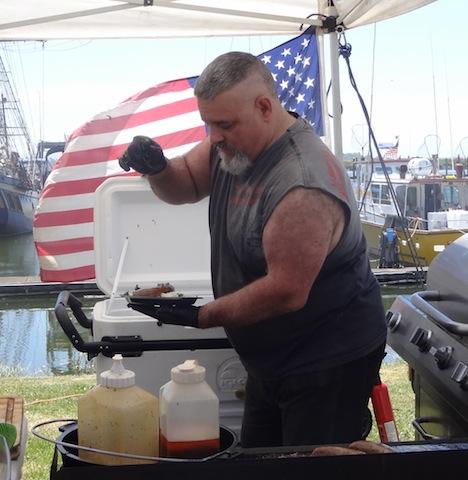 Anthony de Luz of Blue Collar Eats garnishing a plate