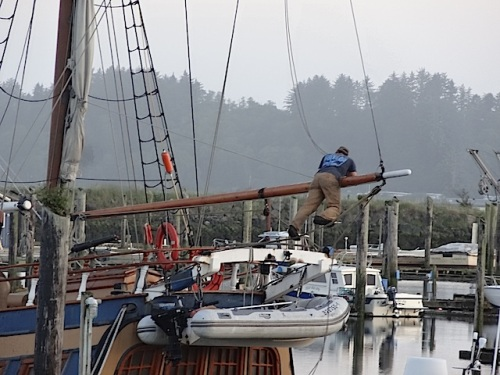 The crews were readying the tall ships to sail away tomorrow.