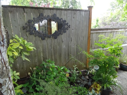 the fence by the garden room