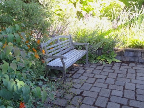 sit spots can be found throughout the garden