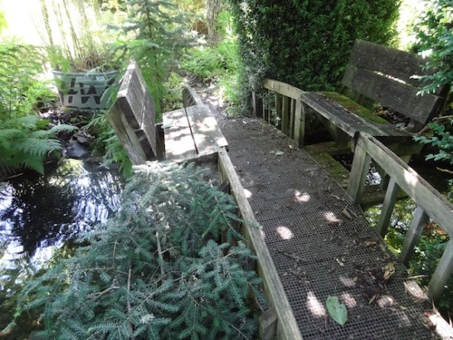 over a stream, a bridge with benches