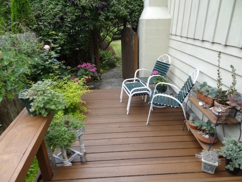 a lower level of the deck on the side of the house