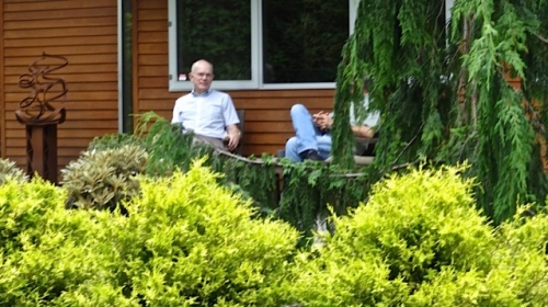 John and Steve awaiting our arrival as if they had not been out grooming the garden. (Allan's photo)