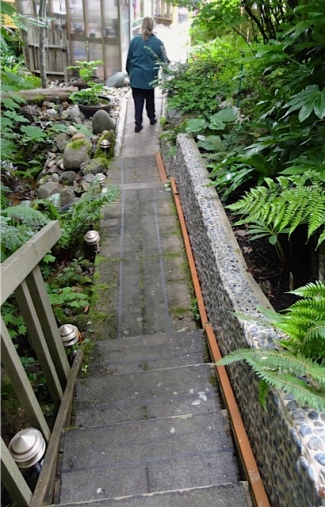 I am walking away; Allan goes on up the path and stairs.