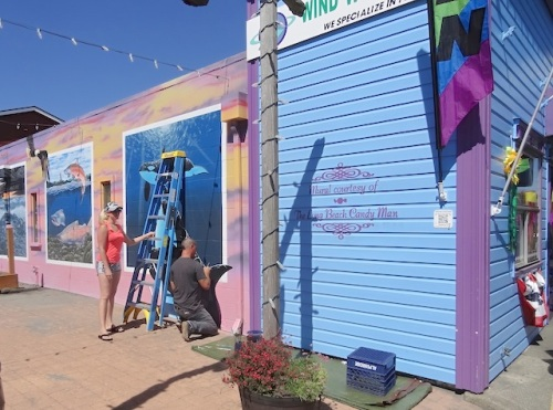 Mural painting continues in Fish Alley. I noticed the lettering saying that the Long Beach Candy Man has sponsored the project.