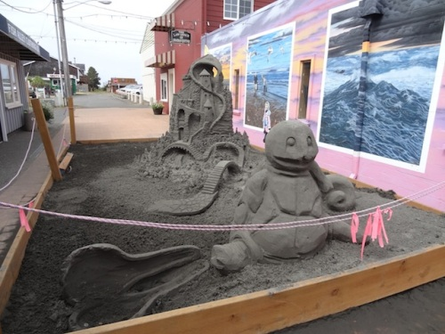 This week's sand sculpture in Fish Alley. (I bucket watered the four alley planters.)
